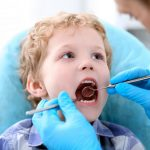 child in dentists chair